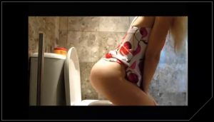 Very sexy blonde pooping in the toilet